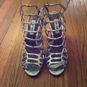 Never worn Popular caged Sandal